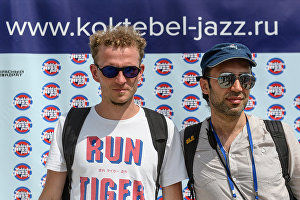 The Authentic Light Orchestra band members Andrei Krasilnikov, left, and Valery Tolstov at a news conference with Koktebel Jazz Party International Music Festival participants.