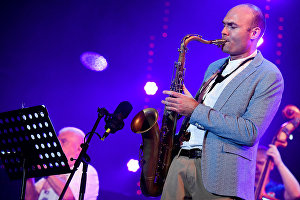 Sax player Sergei Golovnya performs live during Valery Ponomaryov's Messengers from Russia program at the Koktebel Jazz Party 2017 festival.