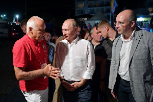 Russian President Vladimir Putin attends the Koktebel Jazz Party 2017 international festival in Koktebel. Left: Rossiya Segodnya International Information Agency Director General Dmitry Kiselev