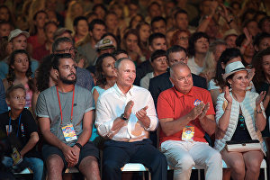 Russian President Vladimir Putin attends Koktebel Jazz Party 2017 festival. 2nd right: Rossiya Segodnya International Information Agency Director General Dmitry Kiselev