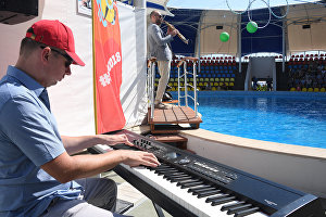 A live concert featuring saxophonist Sergei Golovnya at the Dolphinarium during the 16th Koktebel Jazz Party international music festival