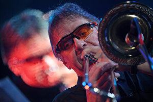 Trombonist Conrd Herwig, center, performs live at the 16th Koktebel Jazz Party international music festival