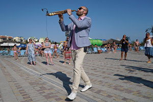 Saxophonist Sergei Golovnya performs at the 16th Koktebel Jazz Party international music festival