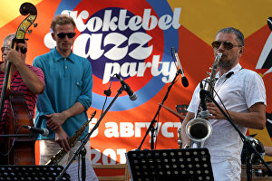Saxophonist German Lukyanov, right, performs on the Voloshinskaya Stage at the 16th Koktebel Jazz Party international music festival
