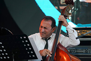A member of the band lead by Vahagn Hayrapetyan (Armenia) performs at the 16th Koktebel Jazz Party international music festival