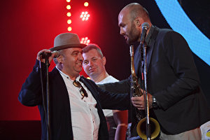 Saxophonist Sergei Golovnya, right, and musician Vahagn Hayrapetyan, left, perform during the All Stars KJP Jam with the participation of the big band lead by Sergei Golovin, at the 16th Koktebel Jazz Party international music festival