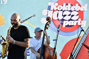 Famous saxophonist and founder of the SG BIG BAND Sergei Golovnya (left) performing at the 17th Koktebel Jazz Party international festival