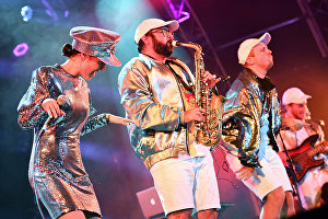 Members of the French electro swing band Lamuzgueule (LMZG) Déborah Reboul, Salvatore Virgone and Romain Deschamps (left to right) performing at the 17th Koktebel Jazz Party international festival